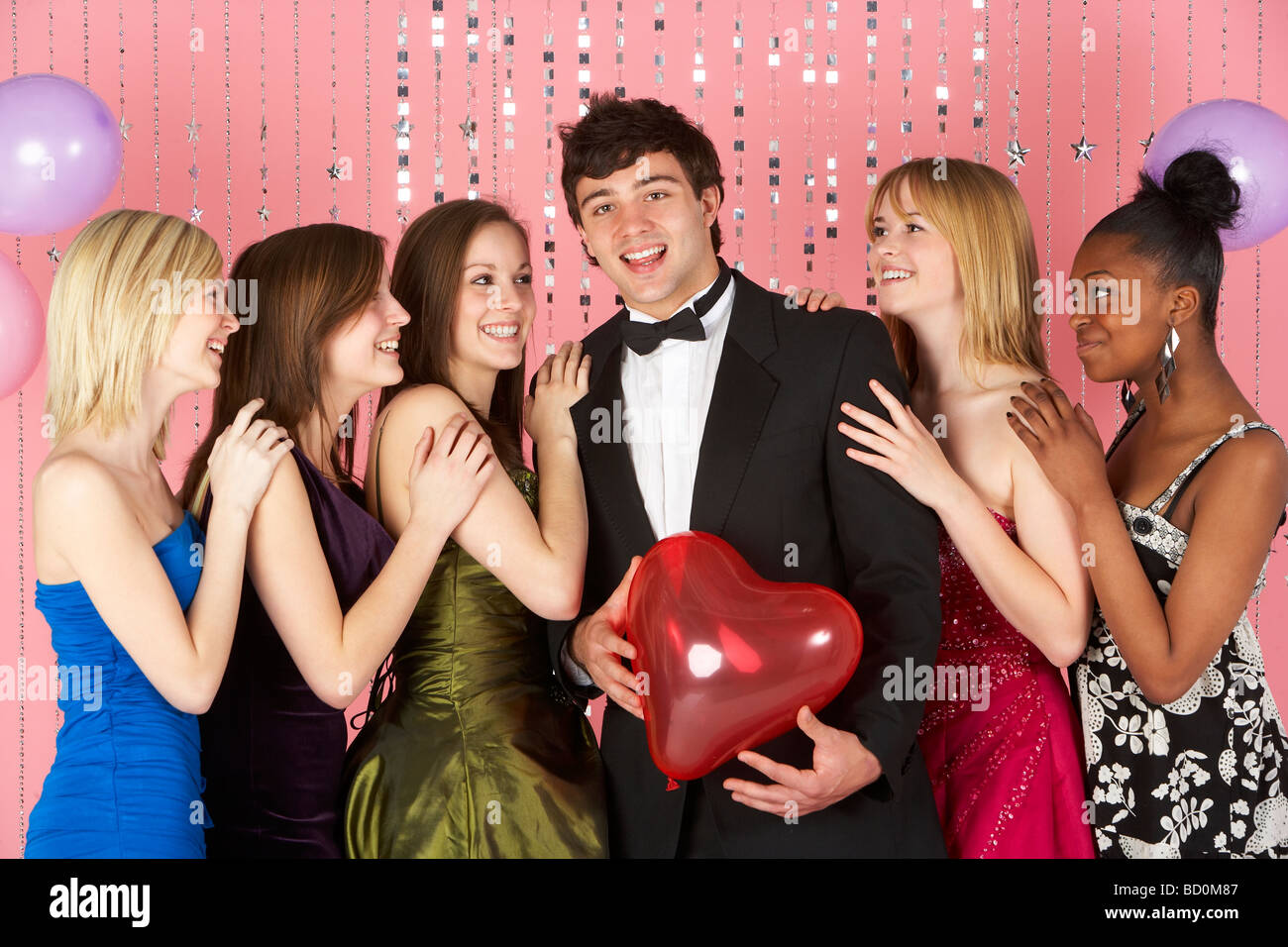 Teenage Girls Looking At Attractive Boy - Stock Image