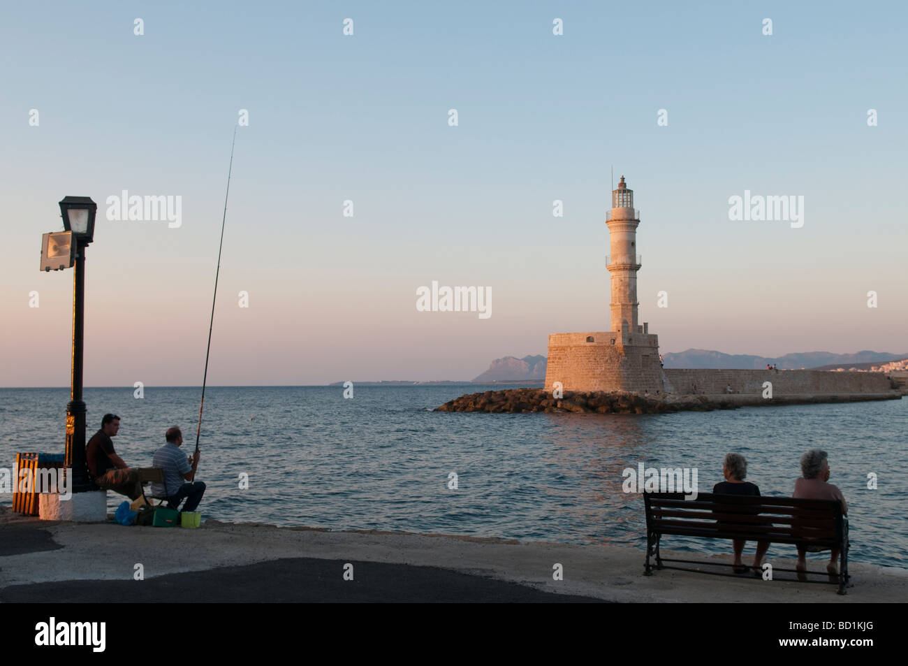 Angling in the Venetian Harbour at sunset. Chania, Crete, Greece - Stock Image