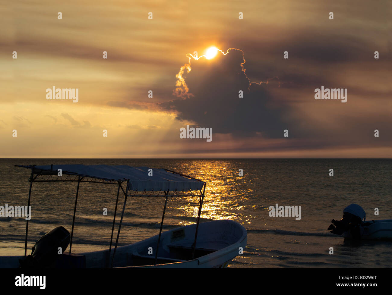 A magnificent sunset over Holbox Island, Quintana Roo, Yucatán Peninsula, Mexico, fishing boat boats clouds - Stock Image