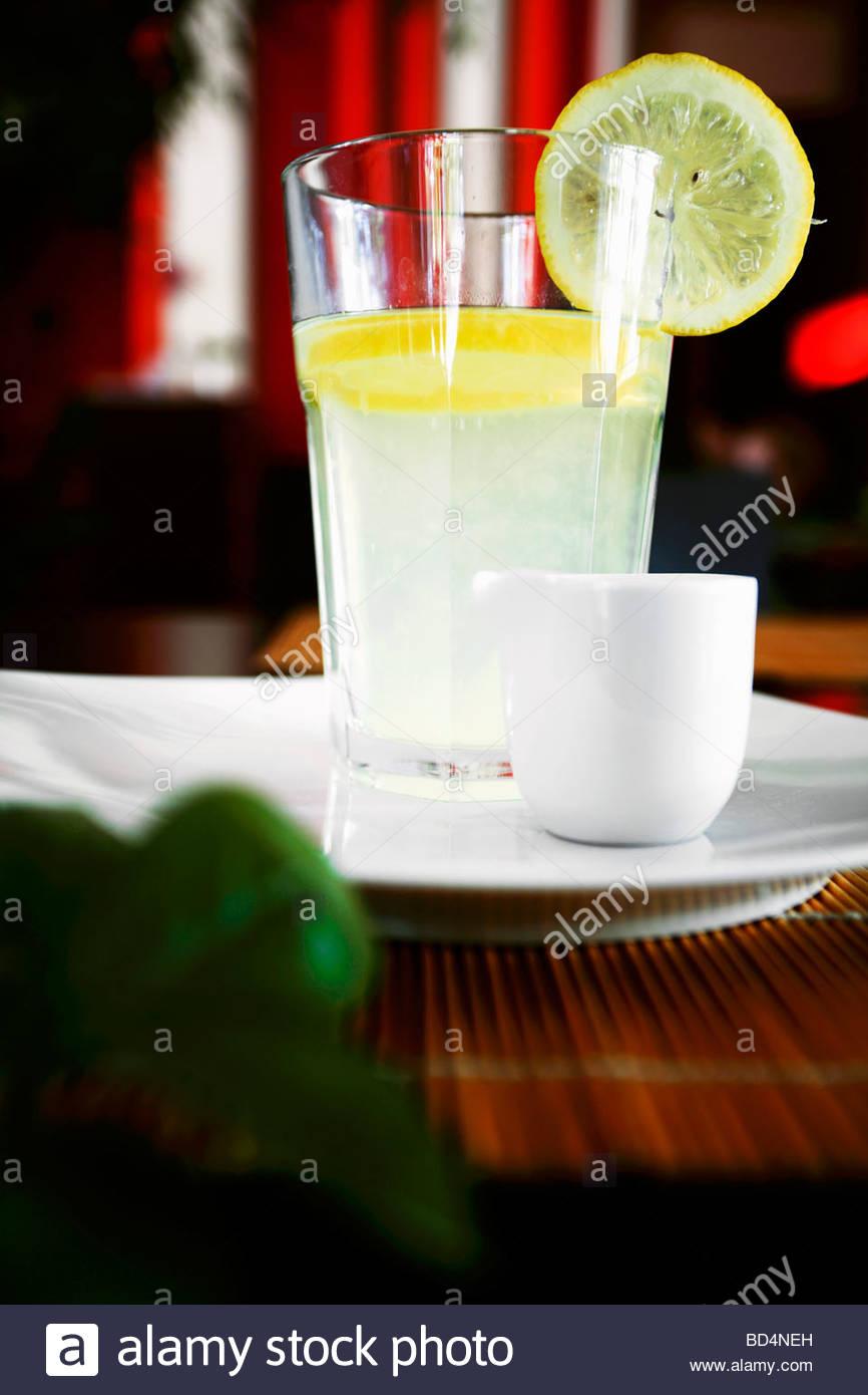 Ginger drink with slice of lemon - Stock Image