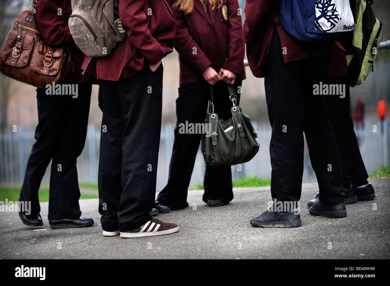 A GROUP OF MIXED SECONDARY SCHOOL CHILDREN IN UNIFORM UK Stock Photo