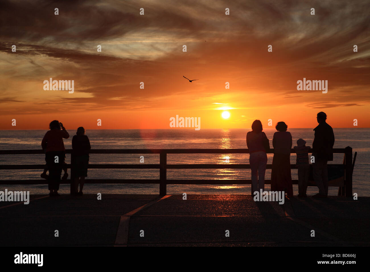 six-people-watching-the-sunset-at-etreta