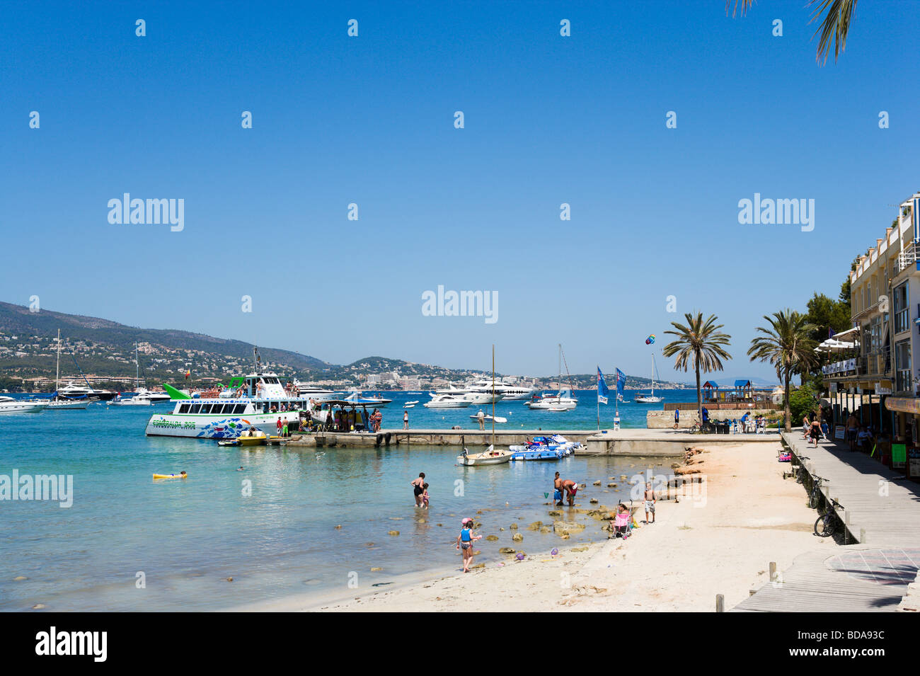 Seafront and excursion boat at Palmanova, Bay of Palma, South Coast, Mallorca, Balearic Islands, Spain Stock Photo