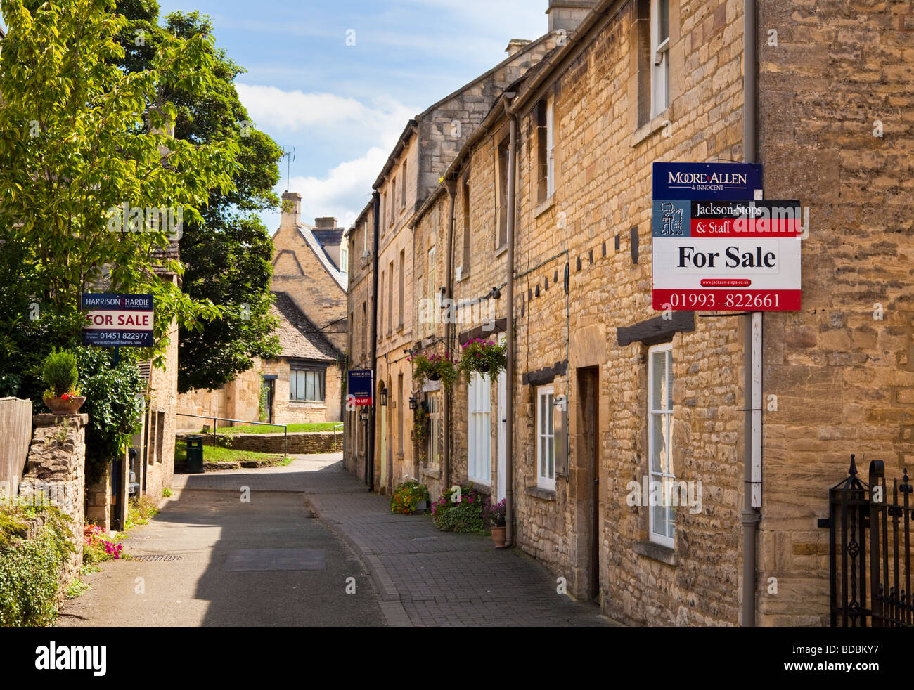 House for sale sign on a village property in Northleach, Gloucestershire, UK Stock Photo