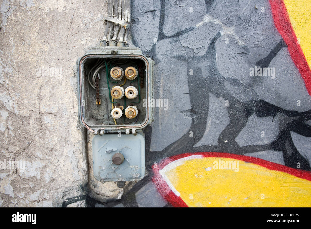old fuse box on abandoned warehouse wall - Stock Image