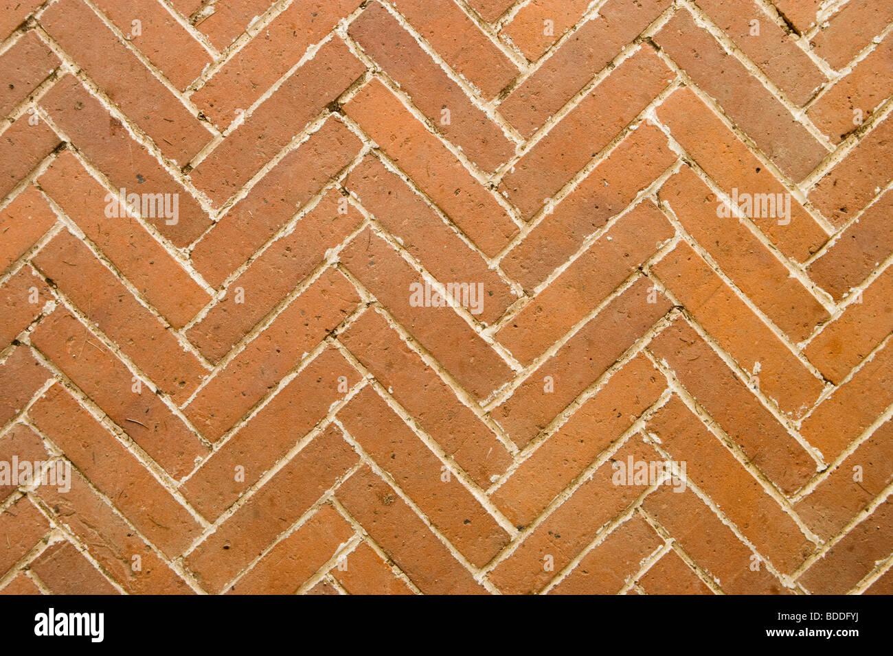Brick paving in herringbone pattern. - Stock Image