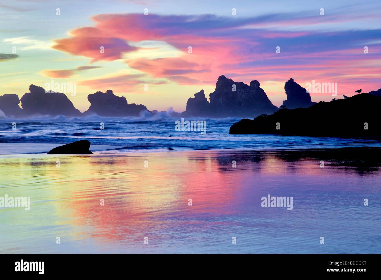Low tide and sunset reflection at Bandon, Oregon - Stock Image