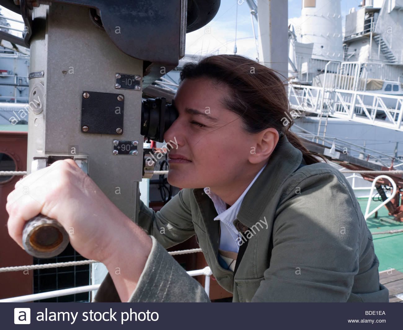 Woman using periscope at Maritime Museum in Gothenburg Sweden - Stock Image
