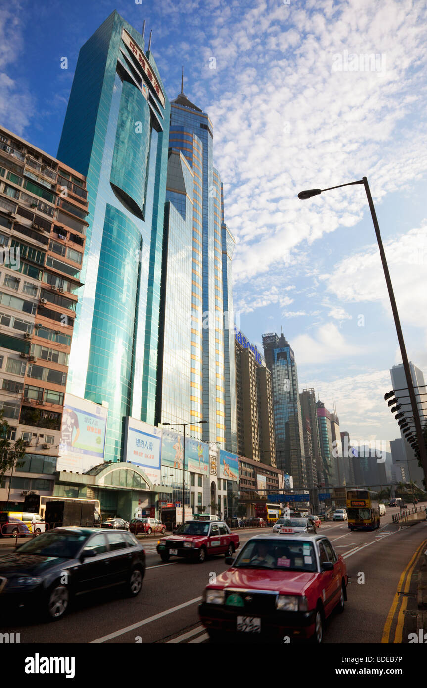 Traffic in front of high rise buildings in Causeway Bay, Hong Kong, China. - Stock Image