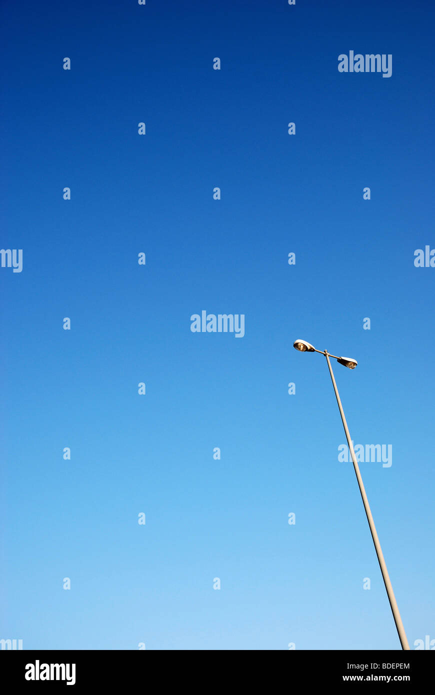 Rest are lamp posts against blue sky - Stock Image