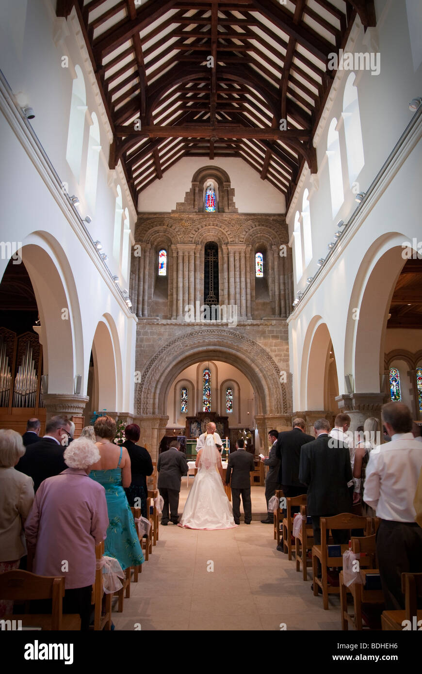Wedding Ceremony Indide Church Of England Church Looking Up Aisle