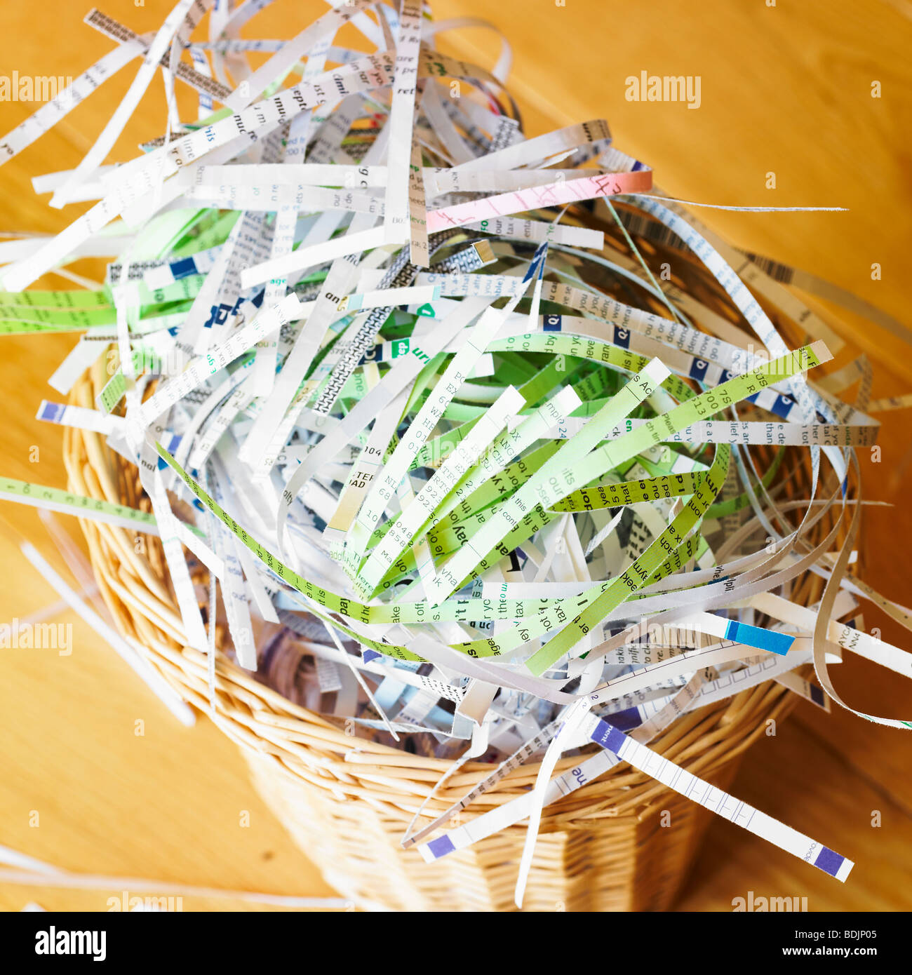 Shredded paper and letters in waste bin - identity theft protection. - Stock Image