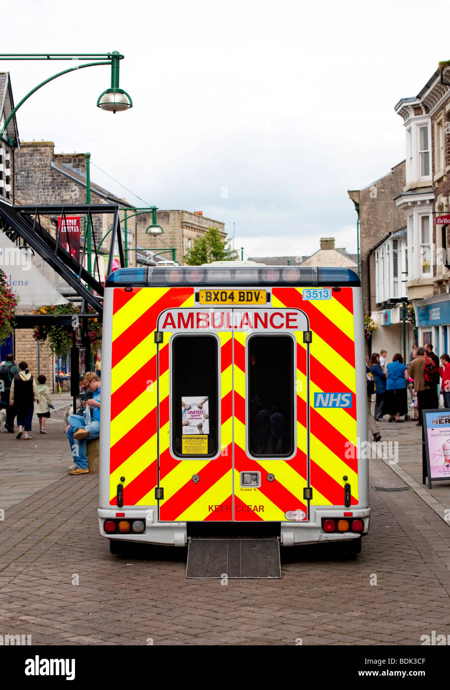 Back view of Ambulance parked in a pedestrian precinct in Buxton, Derbyshire - Stock Image