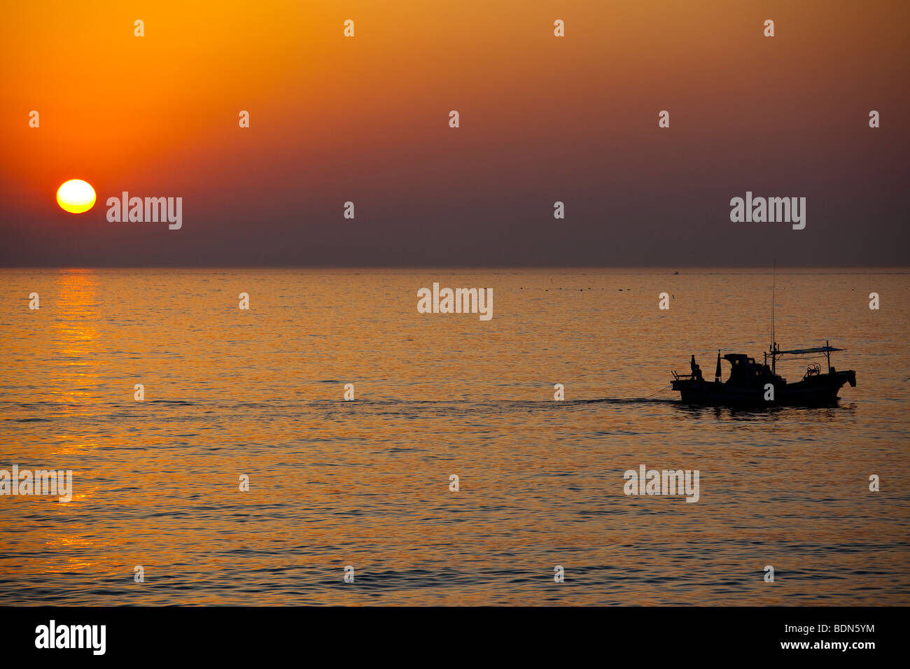 Fishing Boat and Sunrise on the East Sea in Sokcho in Gangwondo Province South Korea - Stock Image