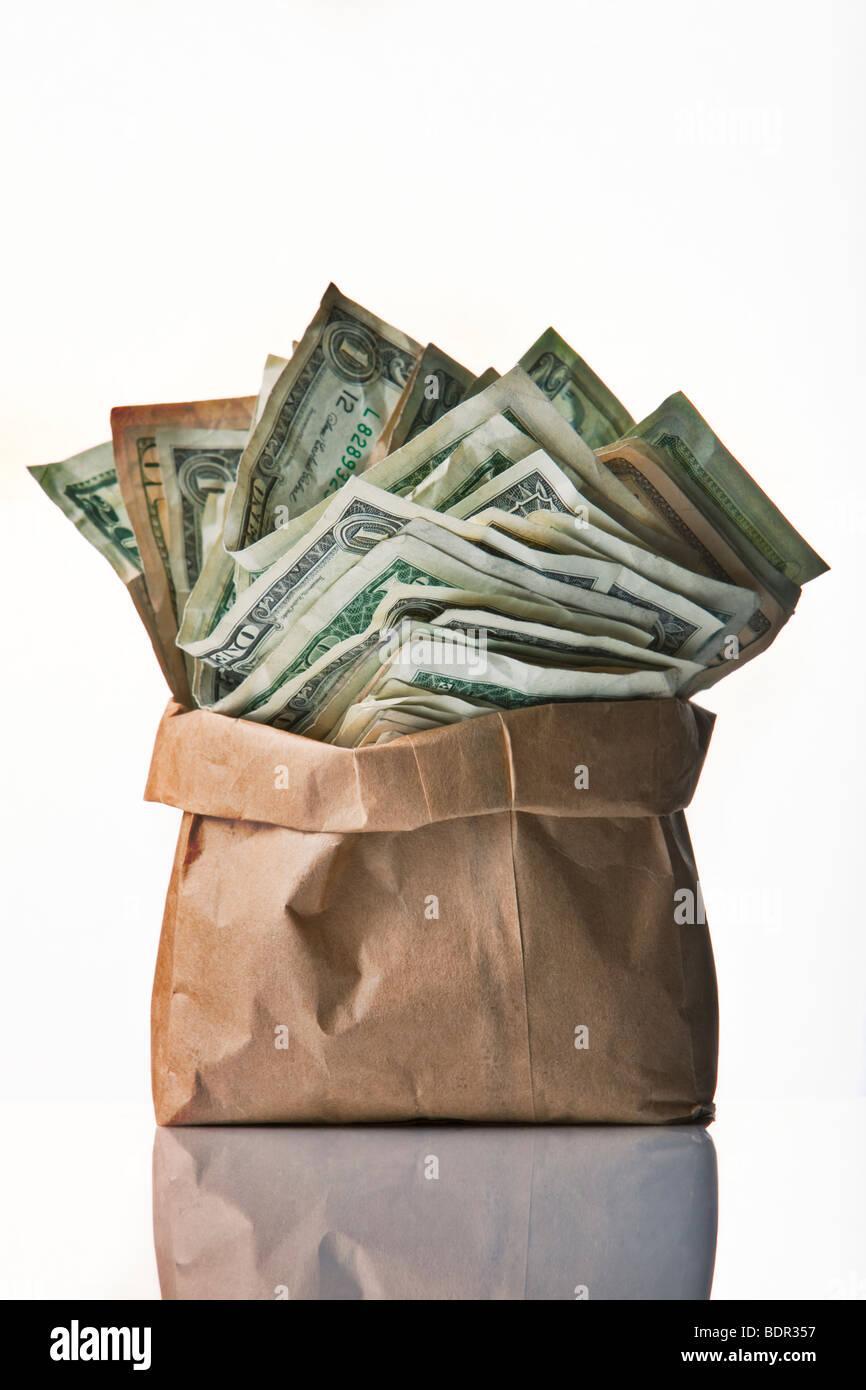 bag of money on white background - Stock Image