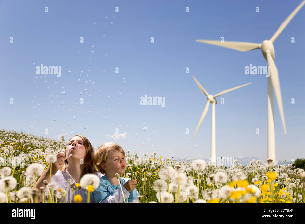 Girl and boy at wind turbine - Stock Image