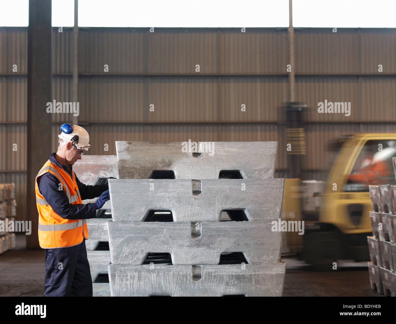 Port Worker With Heavy Cargo - Stock Image