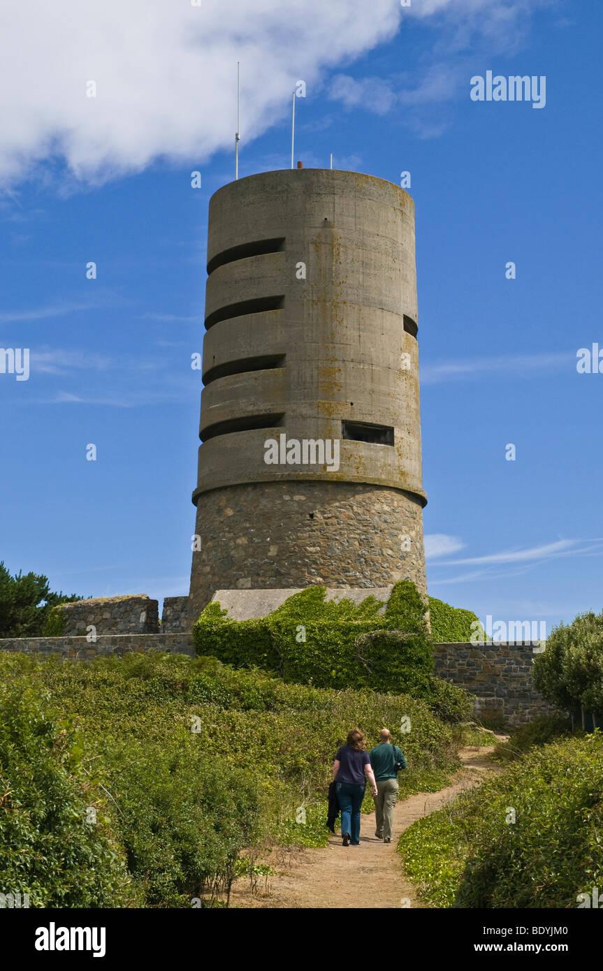 dh Fort Saumarez ST SAVIOUR GUERNSEY Tourist couple German ww2  observation tower footpath people tourists walk - Stock Image