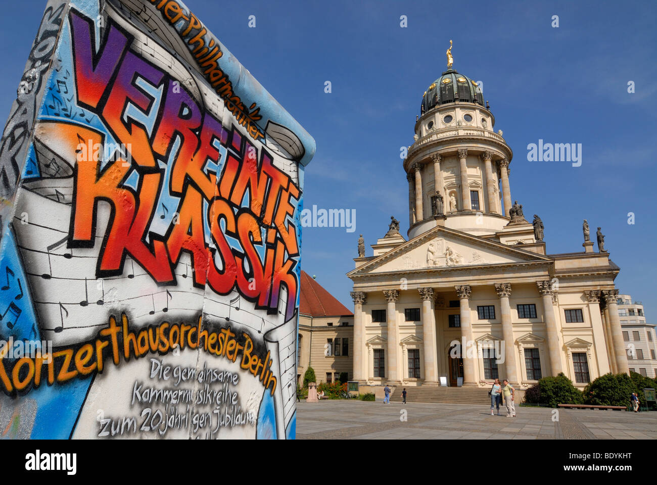Graffiti as advertising on a piece of the Berlin Wall, French Cathedral, Gendarmenmarkt, Berlin, Germany, Europe - Stock Image
