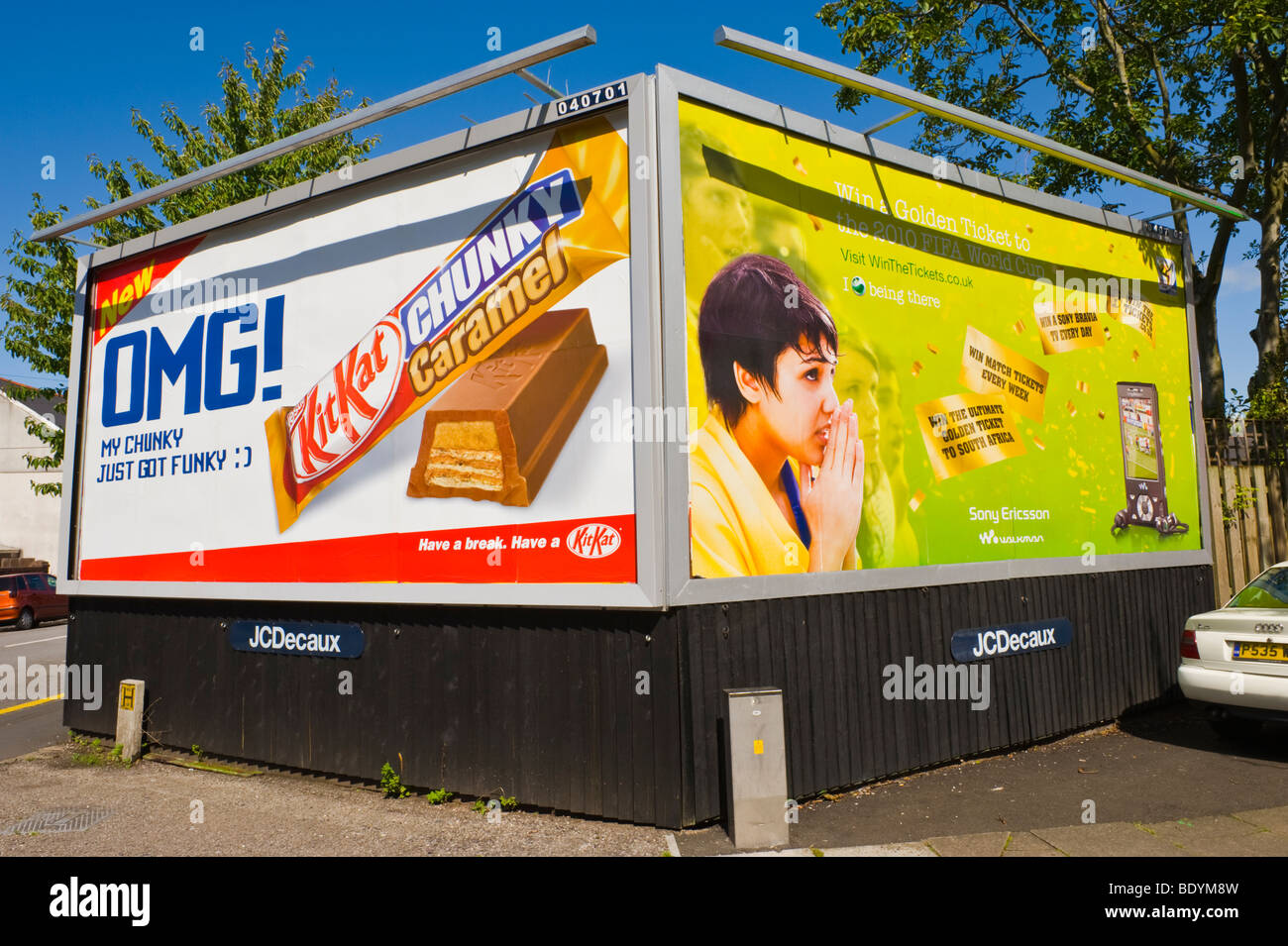 JCDecaux billboards for KitKat and Sony Ericsson Walkman in UK - Stock Image