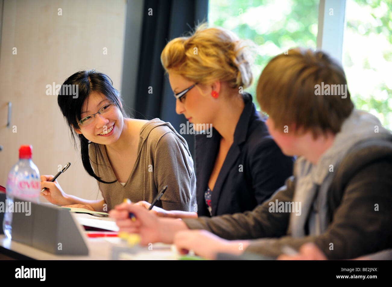 Students in class at sixth form further education college - Stock Image