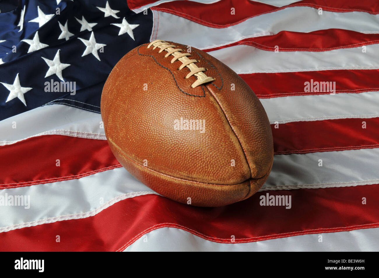 Football against a USA flag on a horizontal format - Stock Image