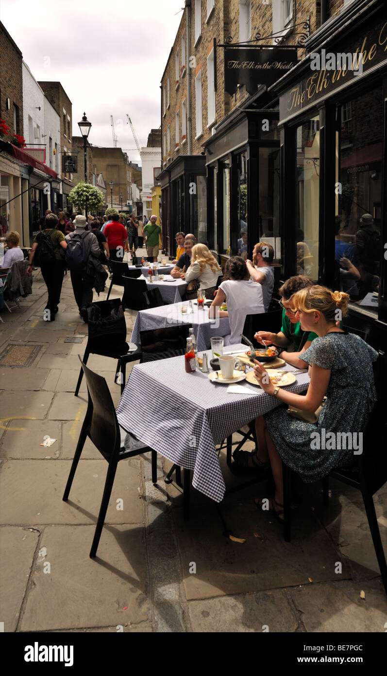diners-at-street-side-cafe-close-to-ange