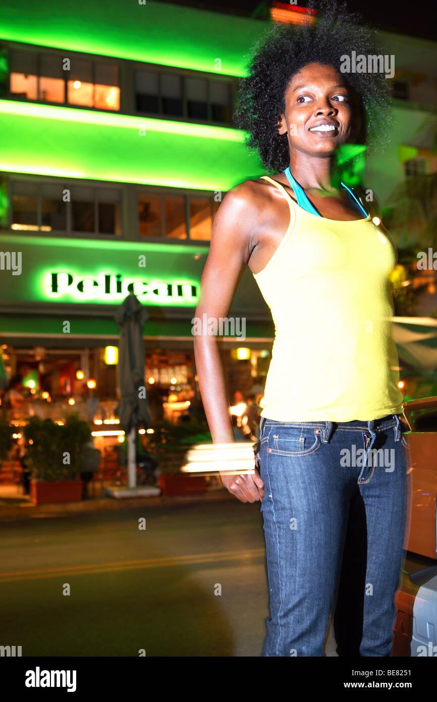 Young woman on Ocean Drive, South Beach, Miami Beach, Florida, USA - Stock Image