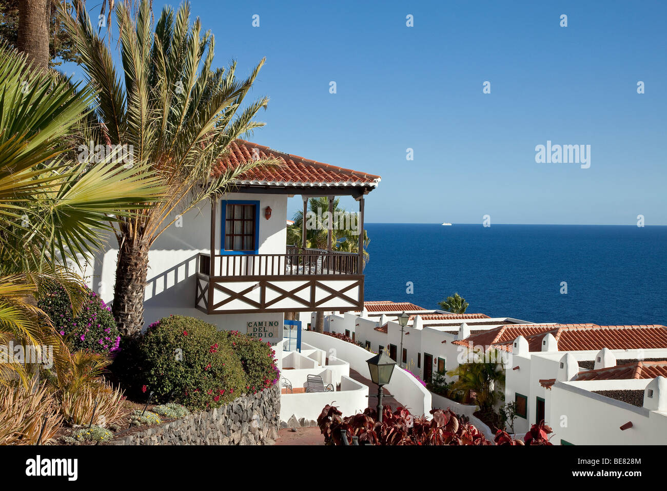 The Jardin Tecina Hotel with sea view in the sunlight, Playa de Santiago, La Gomera, Canary Islands, Spain, Europe - Stock Image