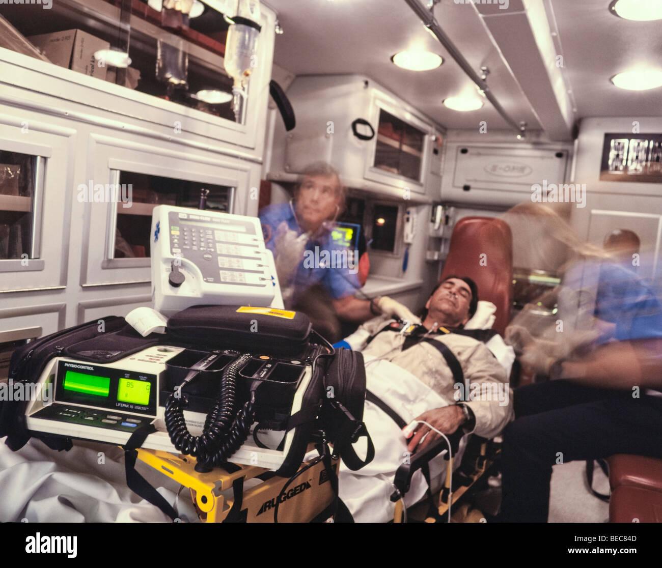 paramedics transport patient in ambulance - Stock Image