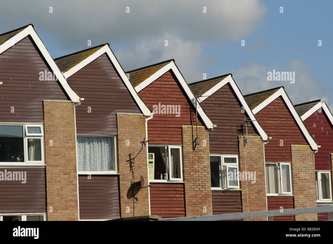 Row of  identical houses built in the 1970's in Tywyn Gwynedd north wales UK Stock Photo