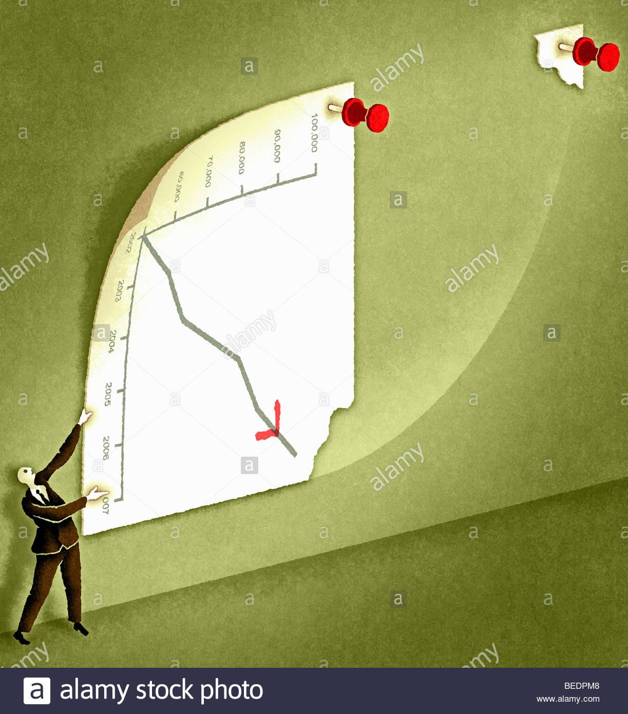 Businessman turning graph to change analysis - Stock Image