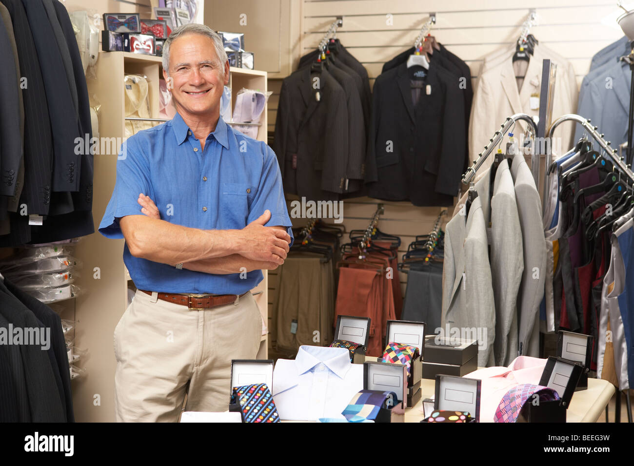 Male sales assistant in clothing store - Stock Image