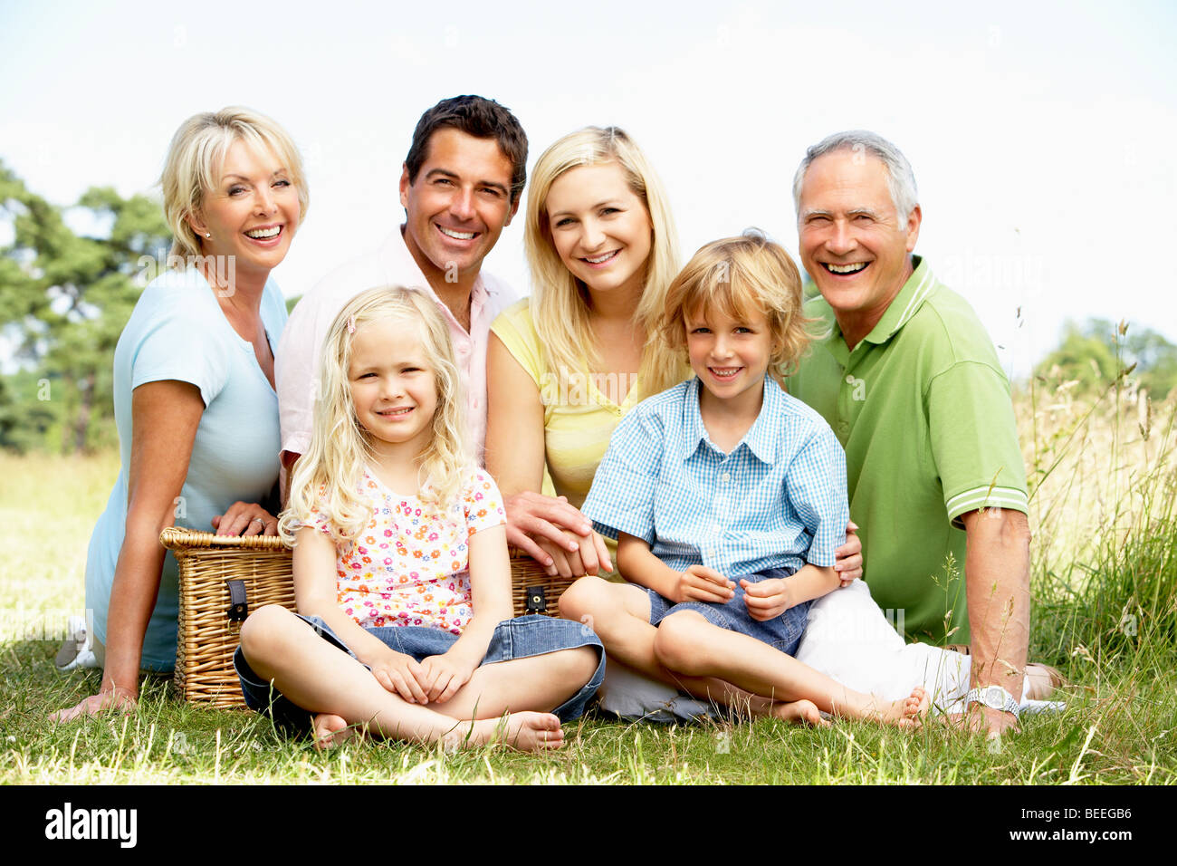 Family having picnic in countryside - Stock Image