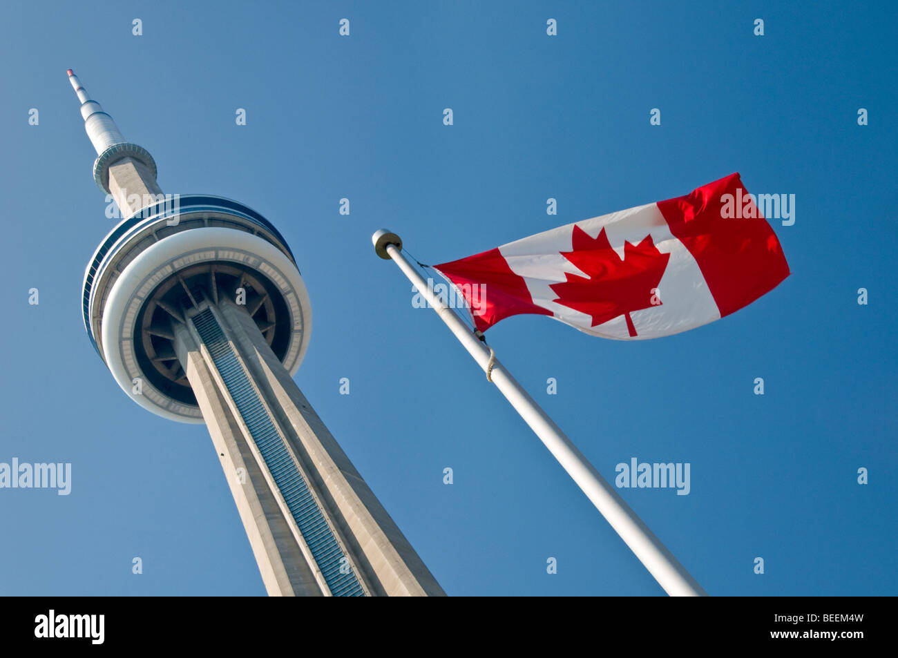 The CN Tower and Canadian National Flag, Toronto, Ontario, Canada, North America - Stock Image