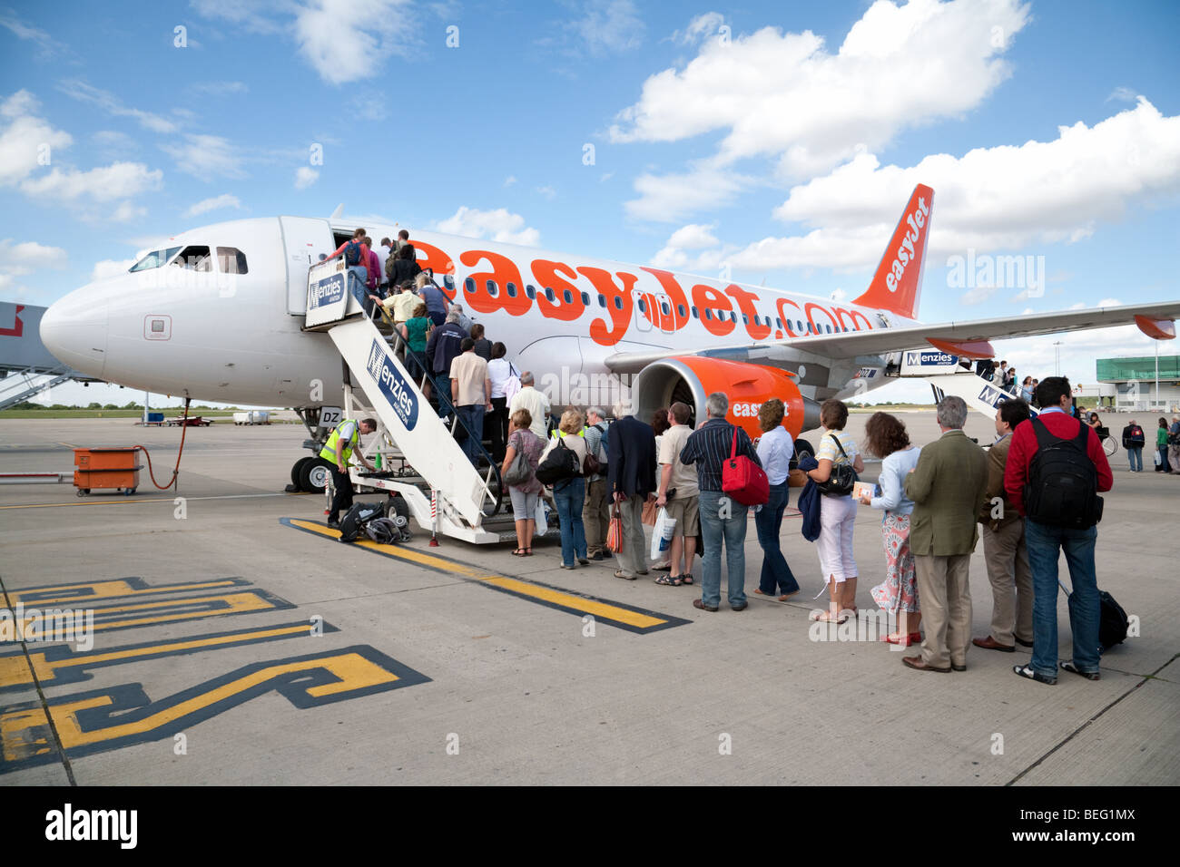 Passengers boarding an Easyjet plane at Stansted airport, UK Stock Photo