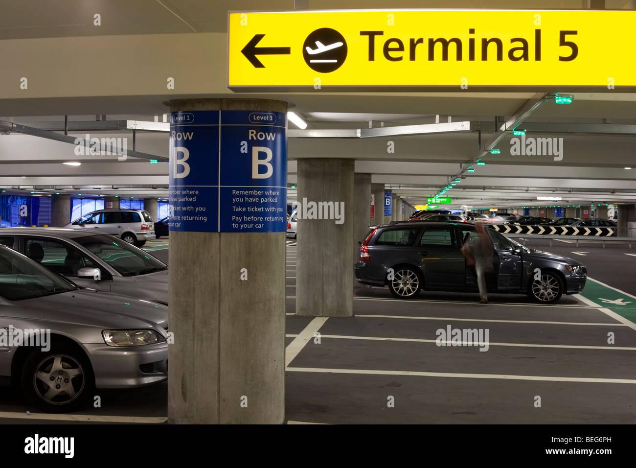 man-closes-vehicle-door-and-car-park-arc