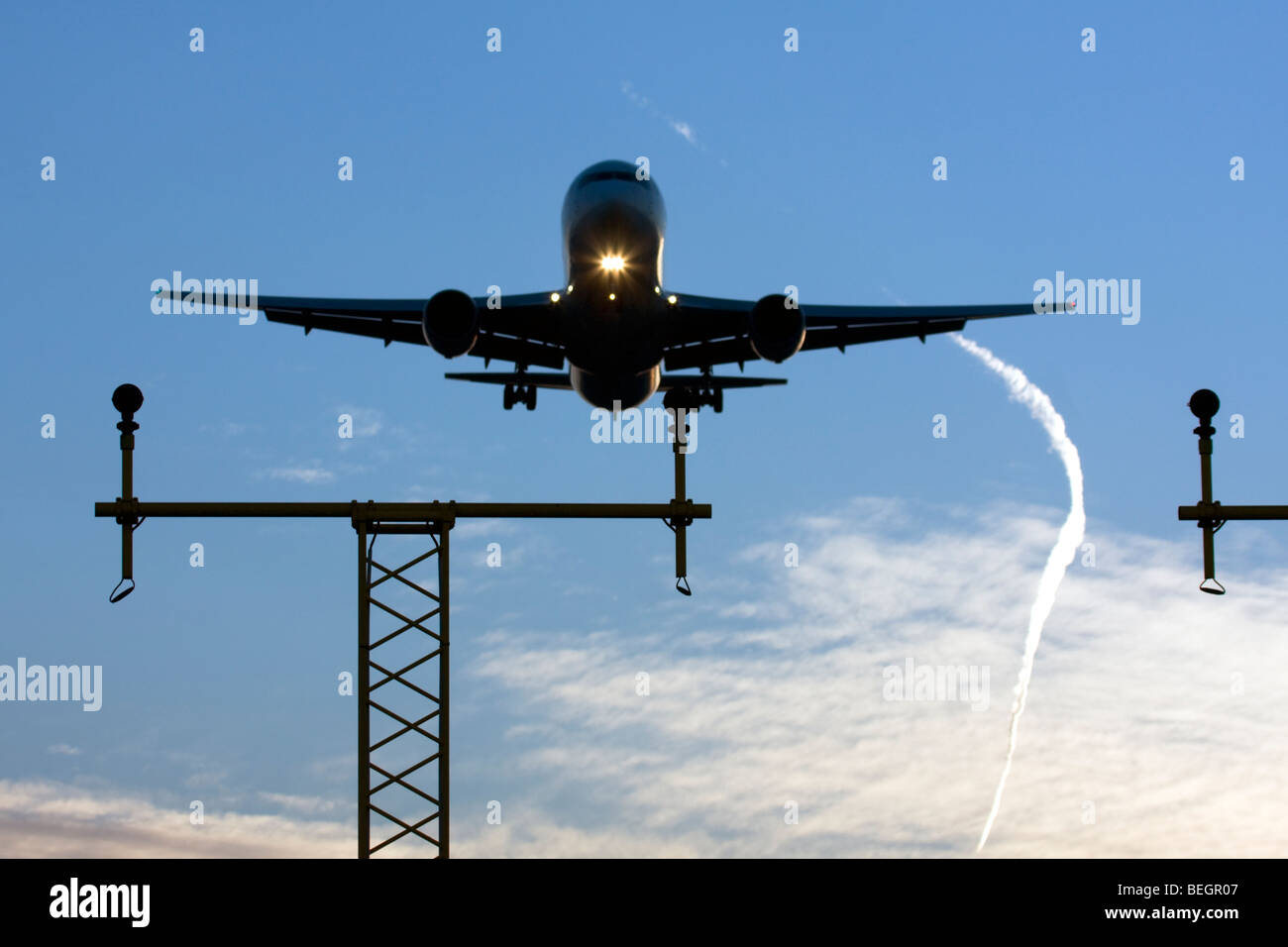 Commercial airliner on approach London Heathrow Airport UK - Stock Image