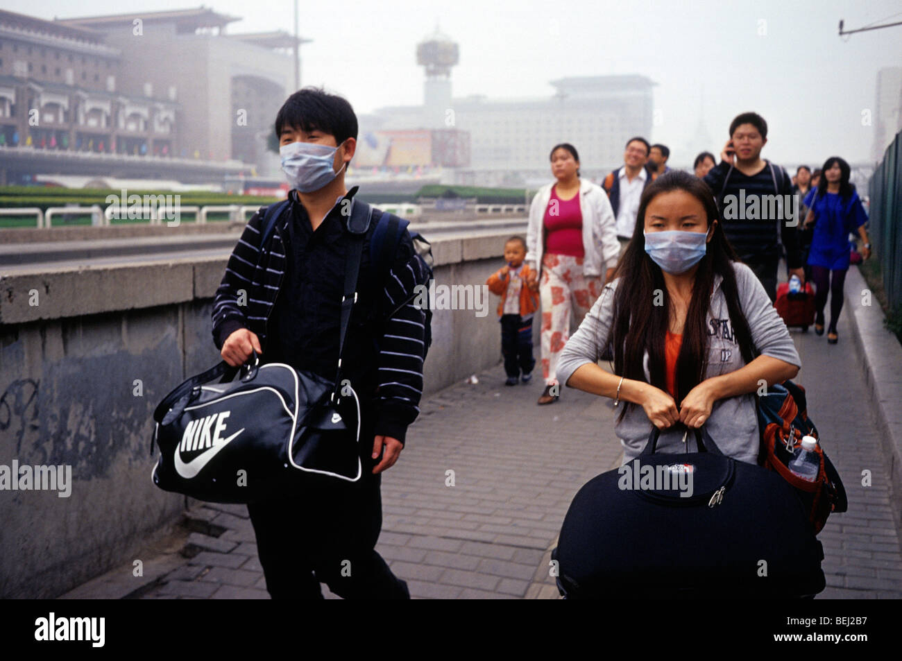 A man and a woman wear masks to protect against severe pollution in Beijing, China. 30-Sep-2009 - Stock Image