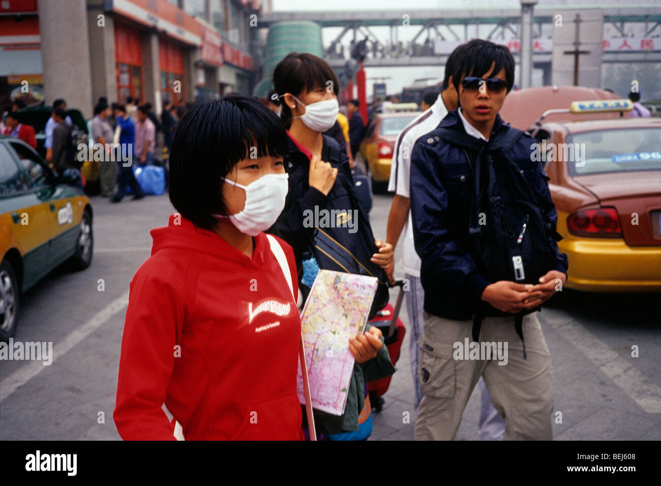 A girl and a lady wear mask to protect against severe pollution in Beijing, China. 30-Sep-2009 - Stock Image