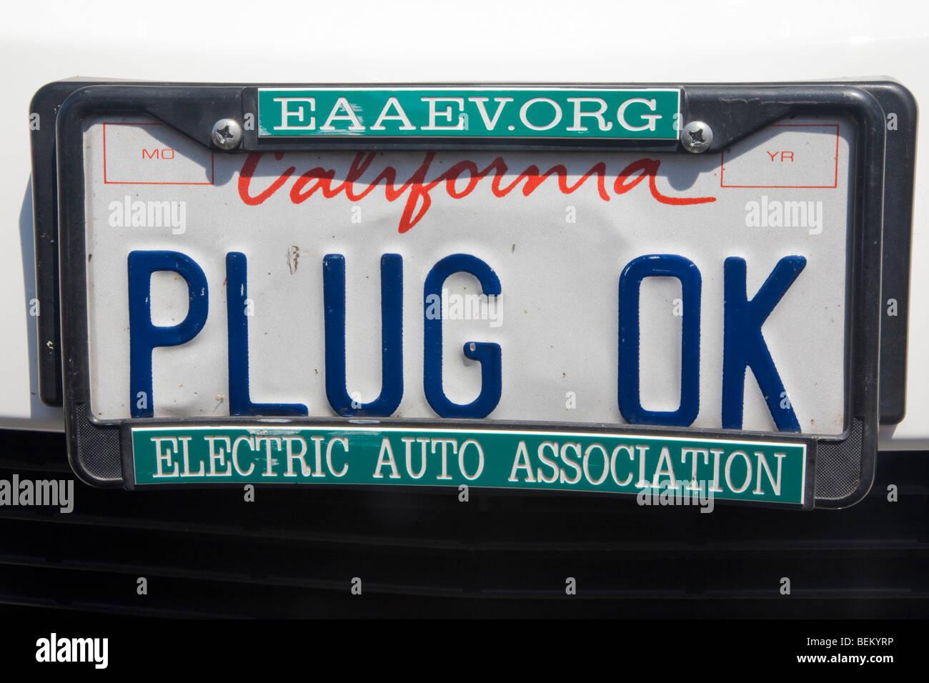 Closeup of 'PLUG OK' license plate on a Toyota Prius. Palo Alto, California, USA - Stock Image