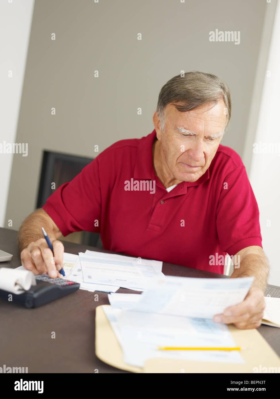 Senior man checking home finances. Copy space - Stock Image