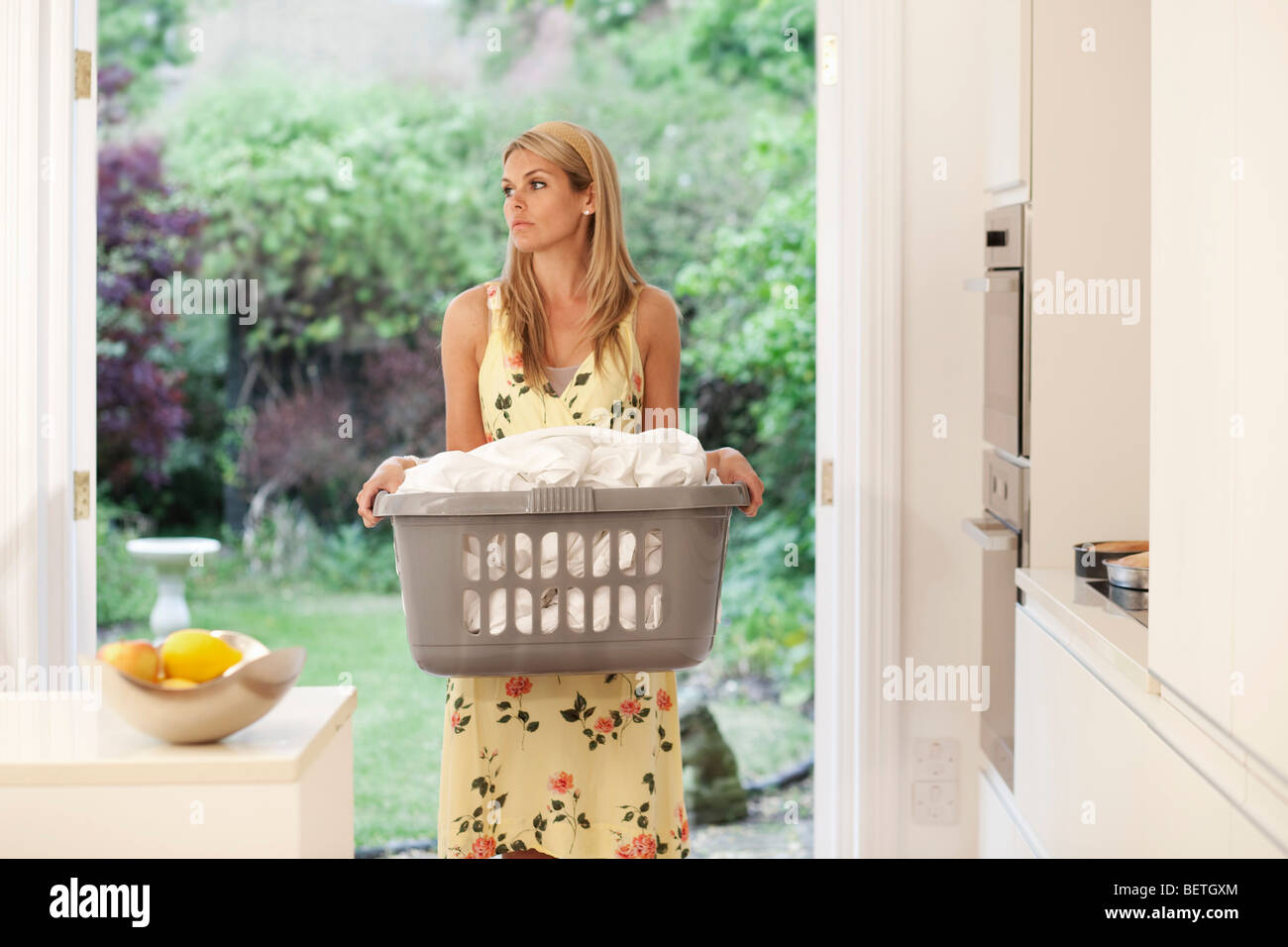 Young woman depressed at housework - Stock Image