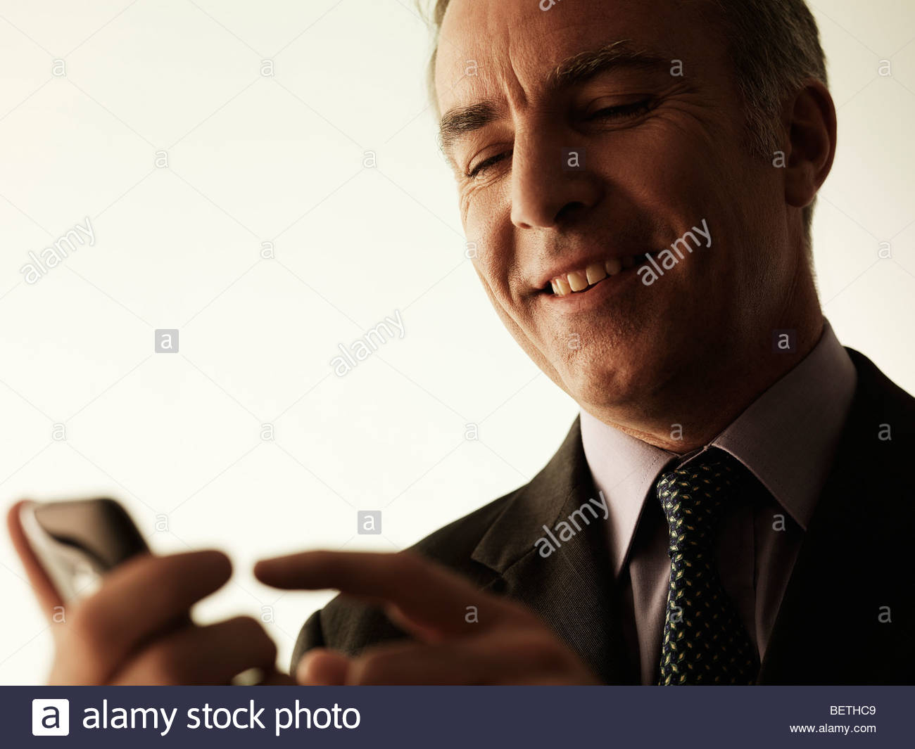 businessman using mobile technology - Stock Image