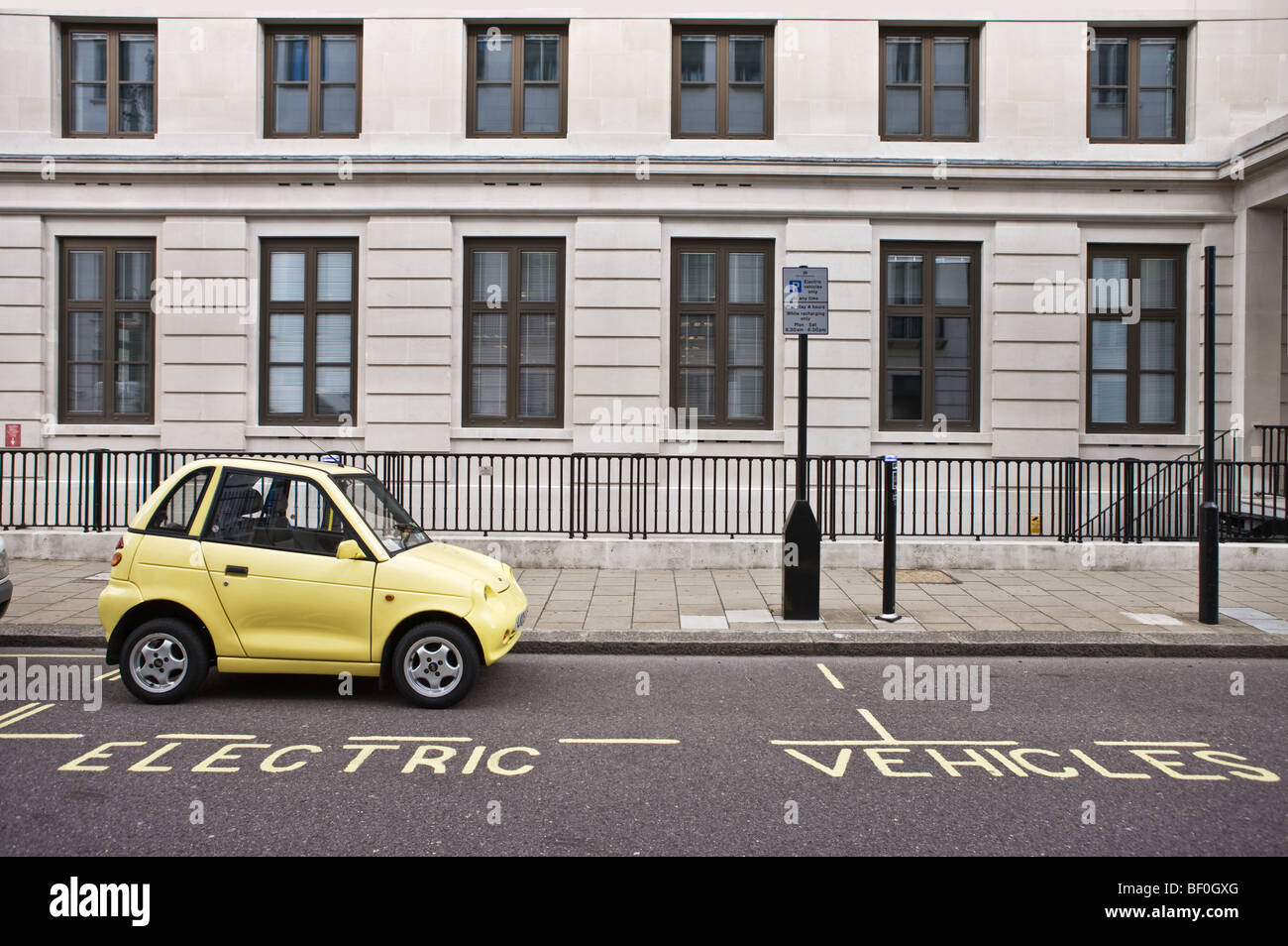 An Electric Car charges up at one of Westminster's 'Juice Point'  parking bays - Stock Image