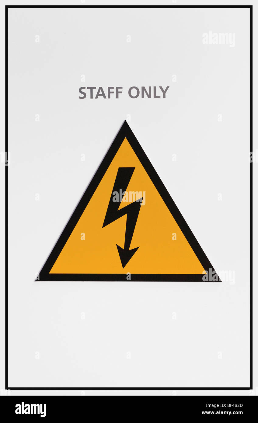 Warning sign, staff only, warning of dangerous electrical voltage - Stock Image