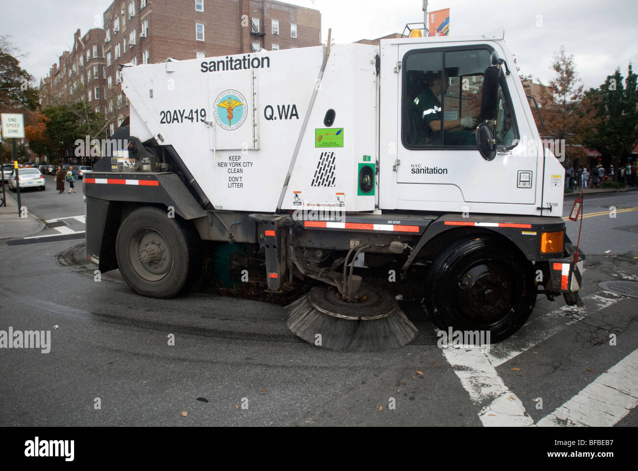 A Dept Of Sanitation Street Sweeper Cleans Up In Jackson Heights - Nyc street sweeping map