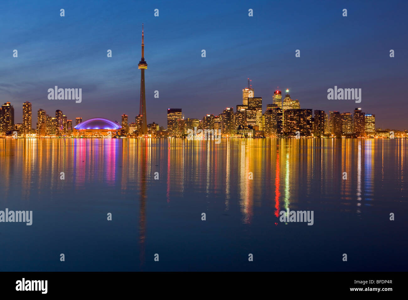 Toronto city skyline seen at dusk from Centre Island, Toronto Islands, Lake Ontario, Ontario, Canada - Stock Image