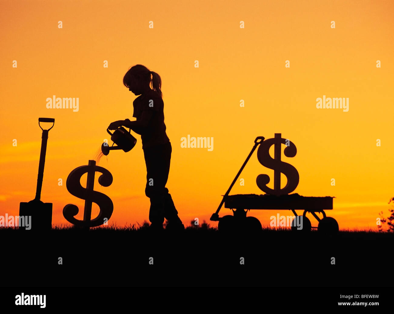 Conceptual of a young girl watering a newly planted dollar sign near Winnipeg, Manitoba, Canada - Stock Image