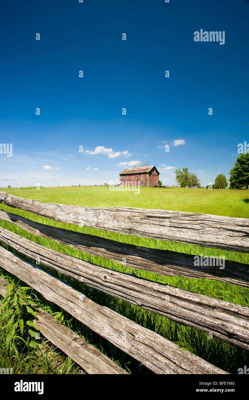 Farm and rail fence, Uxbridge, Ontario, Canada - Stock Image